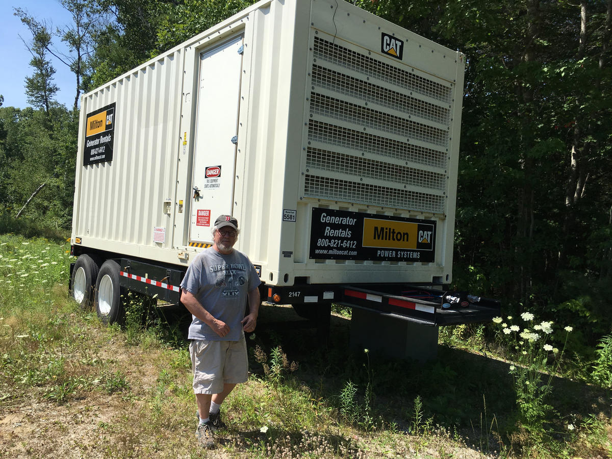 A grid-scale diesel generator near Mike Elkins' furniture-making company can quickly deliver 500 kilowatts of electricity to the Boothbay area. Credit: Fred Bever, MPBN
