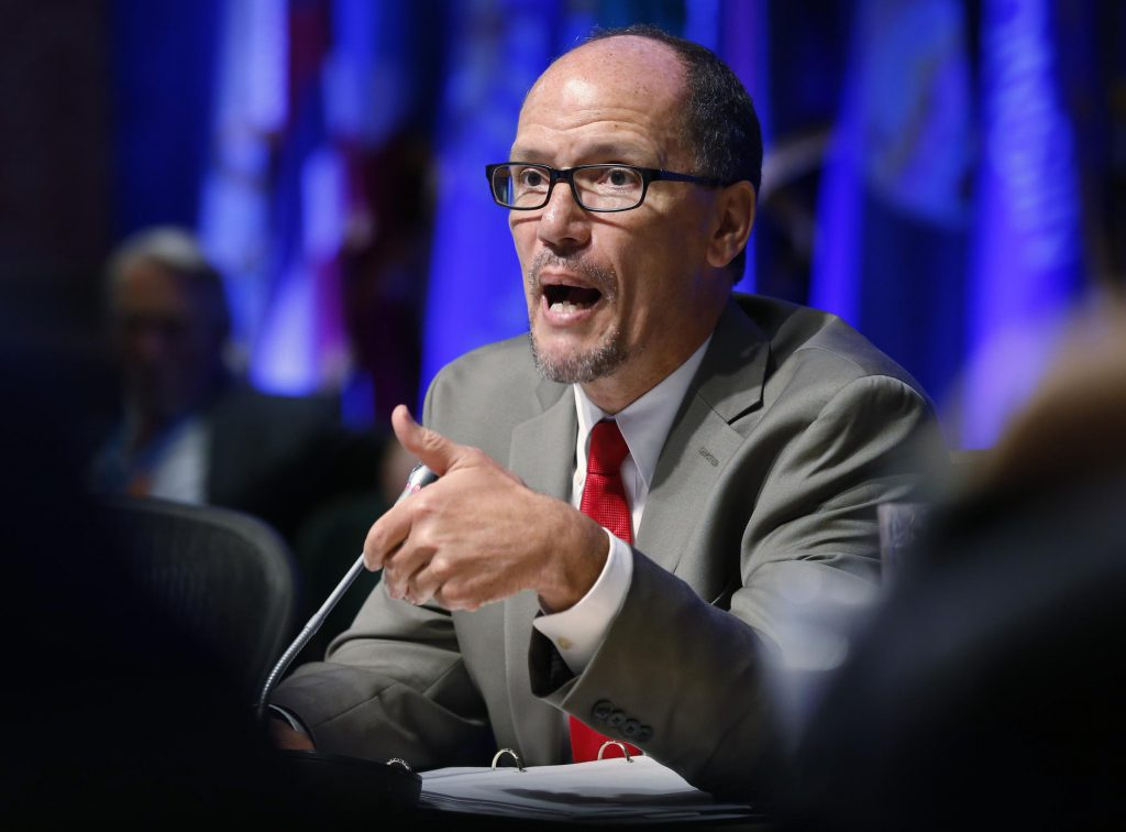 US Labor Secretary Thomas Perez gestures during a presentation during a meeting of the Education and Workforce Committee at the National Governors Association Summer meeting at the Greenbrier in White Sulphur Springs, W. Va., Saturday, July 25, 2015. Credit: Steve Helber, Associated Press.