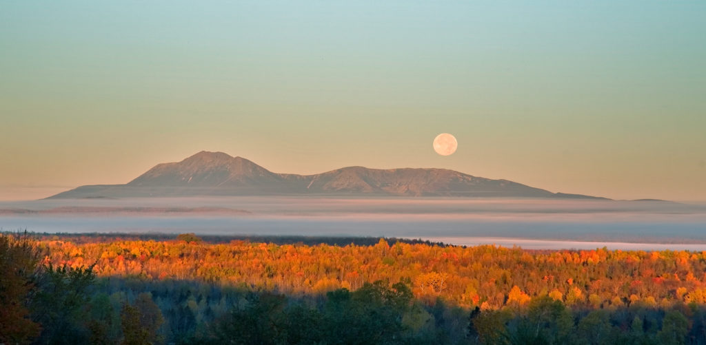 The moon rises over Mt. Katahdin. (Bill Duffy)