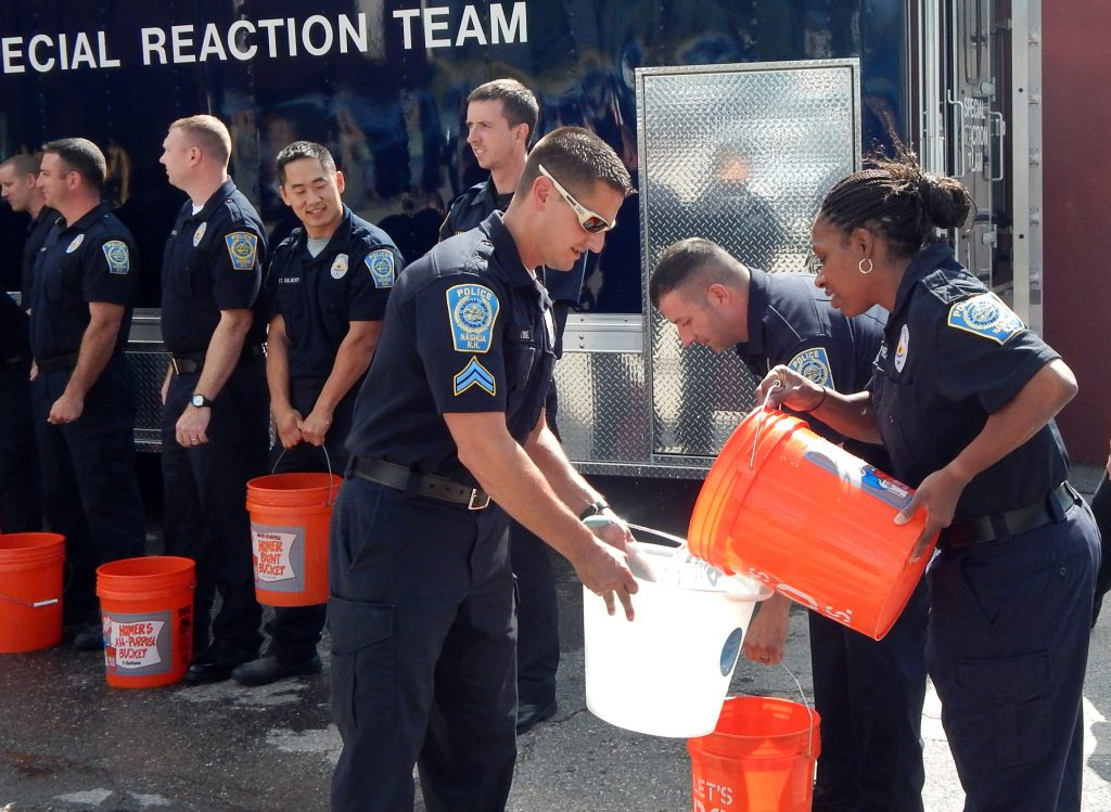 Sergeant Lakeisha Phelps and colleagues at the Nashua, NH police department participated in an ice-bucket challenge to raise awareness for ALS, in August, 2014. Phelps is one of two black police officers in a force of 170. (Credit: Dean Shalhoup/ Nashua Telegraph)