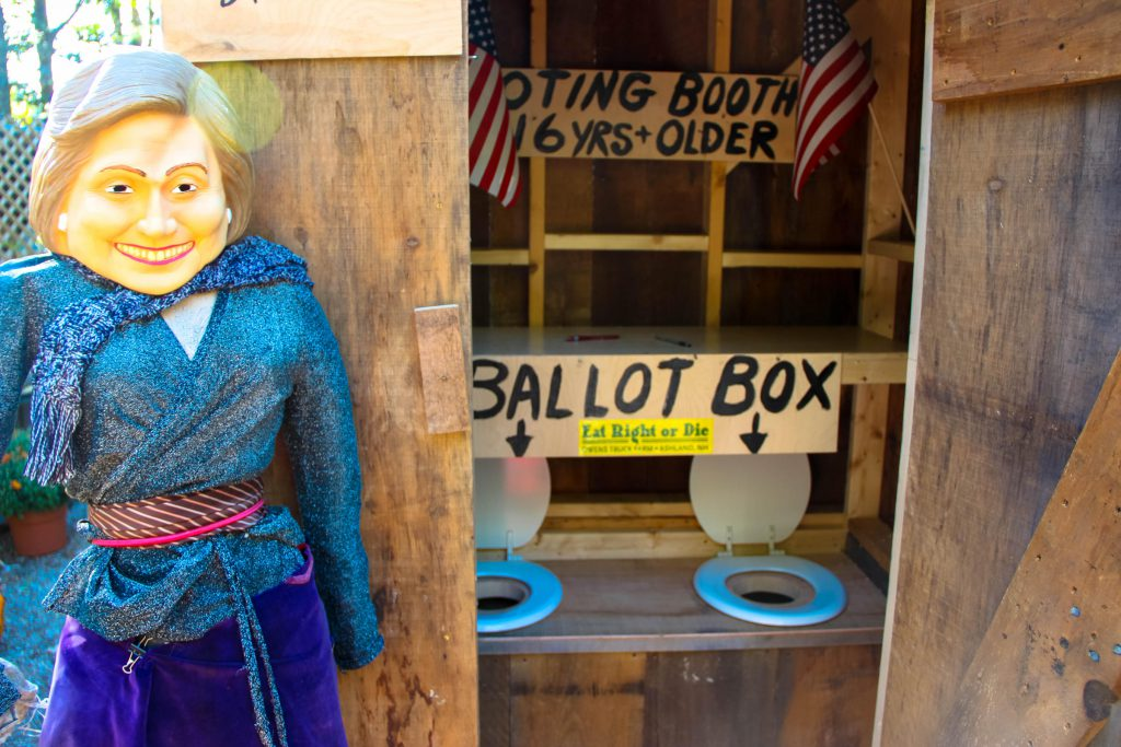 "The rare ""two-seater"" outhouse with a mannequin representing Hillary Clinton. (Credit: Sean Hurley/ NHPR)"