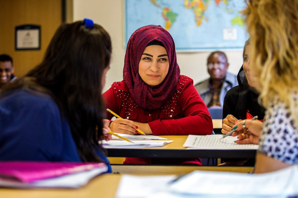 Zainab Khalil Abdo spends time with other students in an English for Speakers of Other Languages (ESOL) class in Lowell, Mass. ( Credit: Jesse Costa/WBUR)