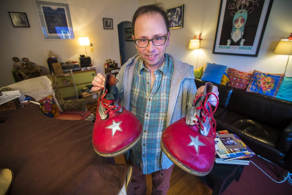 Peter Bufano holds the clown shoes he wore during his tenure as a clown with the Ringling Bros. and Barnum & Bailey Circus. Photo by Jesse Costa for WBUR