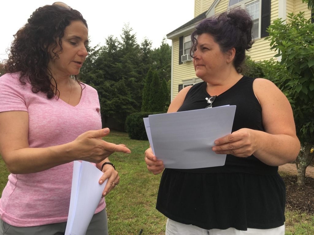 Carol DiPirro talks with neighbor, Andrea Inamorati, about a health survey following water contamination in Merrimack, NH Photo by Emily Corwin for NHPR