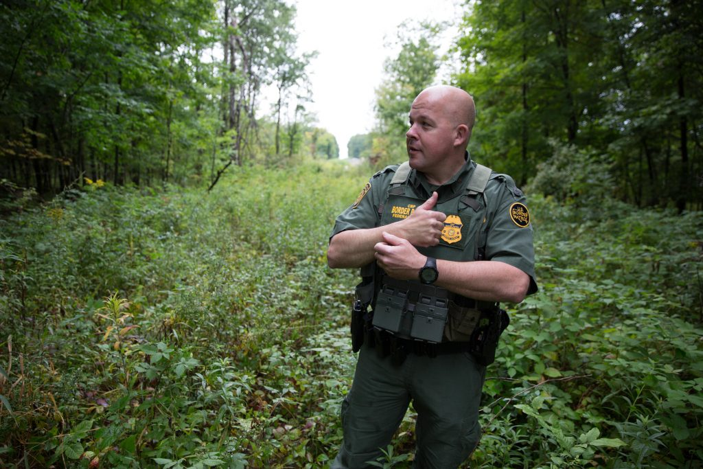 U.S. Border Patrol Agent Brad Brant shows a commonly patrolled area along the U.S.-Canada border, where sometimes people attempt to smuggle drugs and people across the border. Photo by Ryan Caron King for NENC