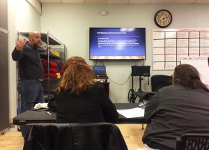 "Director John Burns of SOS Recovery teaches a training on ""compassion fatigue"" in Dover. (Paige Sutherland/NHPR)"
