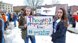 Two marchers outside the State House. (Sean Hurley/NHPR)