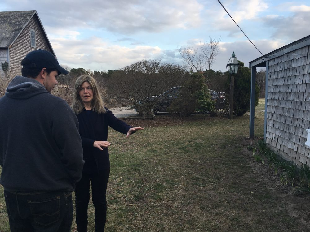 Wescley Pereira and Gail Meister chat about a yard project. The two have been neighbors on Martha's Vineyard for more than a decade. Photo by Shannon Dooling for WBUR