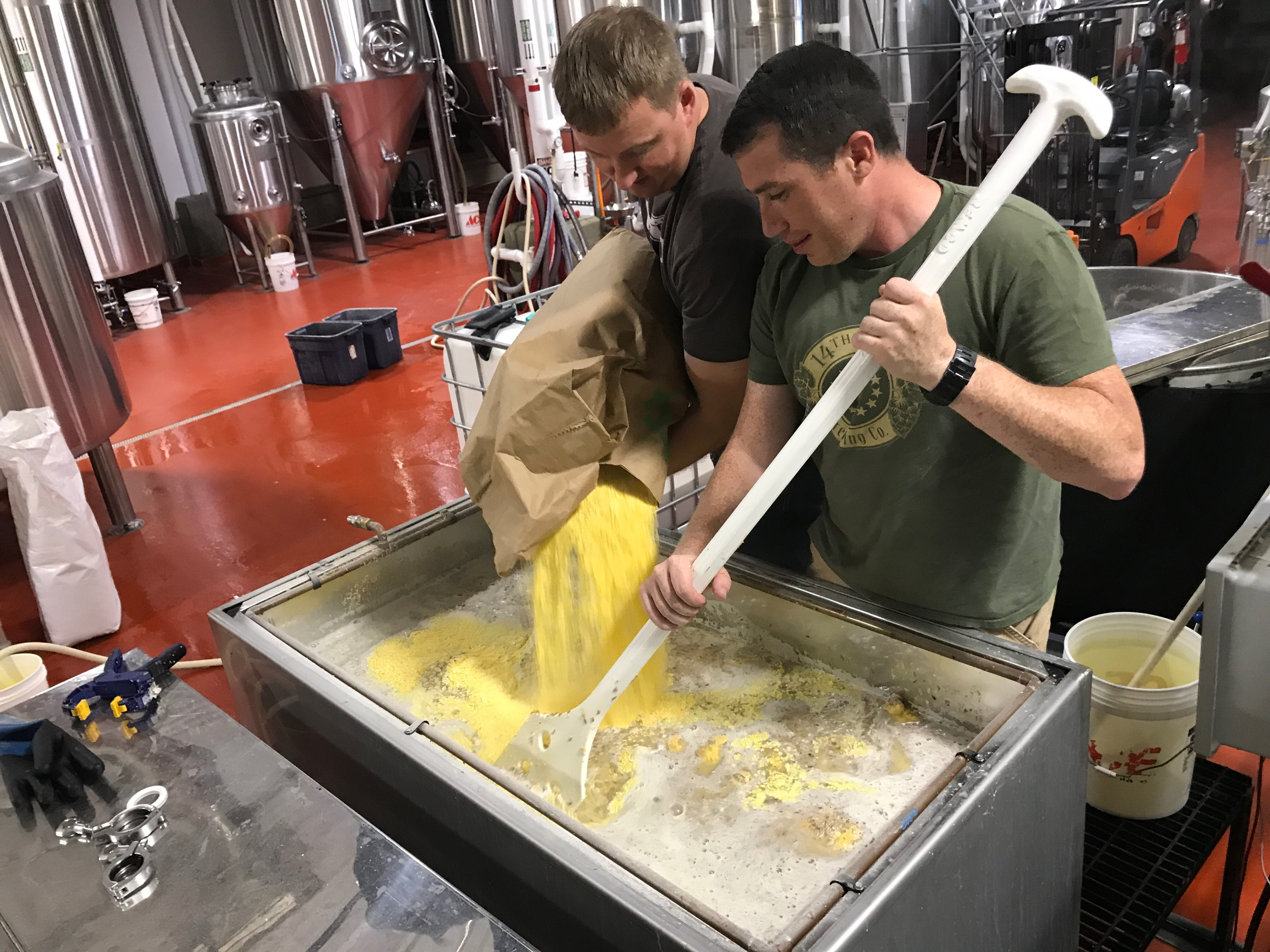Zac Fike (L) and Matt Kehaya (R) work on a batch of beer at 14th Star Brewing Company. 14th Star donates proceeds from every batch to local nonprofits. Courtesy of Danger Close Craft Distilling