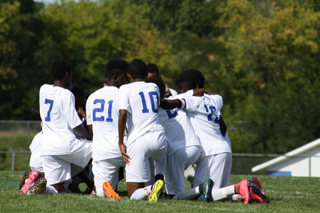 The Lewiston Blue Devils huddle before a game. Photo courtesy of Amy Bass