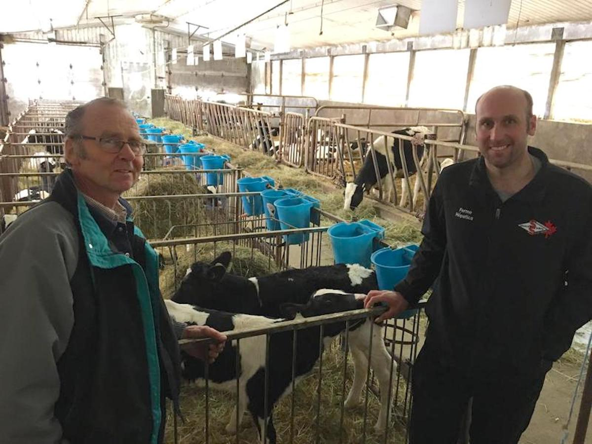 Hans Kaiser and his son Terry operate a dairy farm in St. Armand, Quebec. They say the supply management system in Canada has let them earn a good living. Photo by John Dillon for VPR