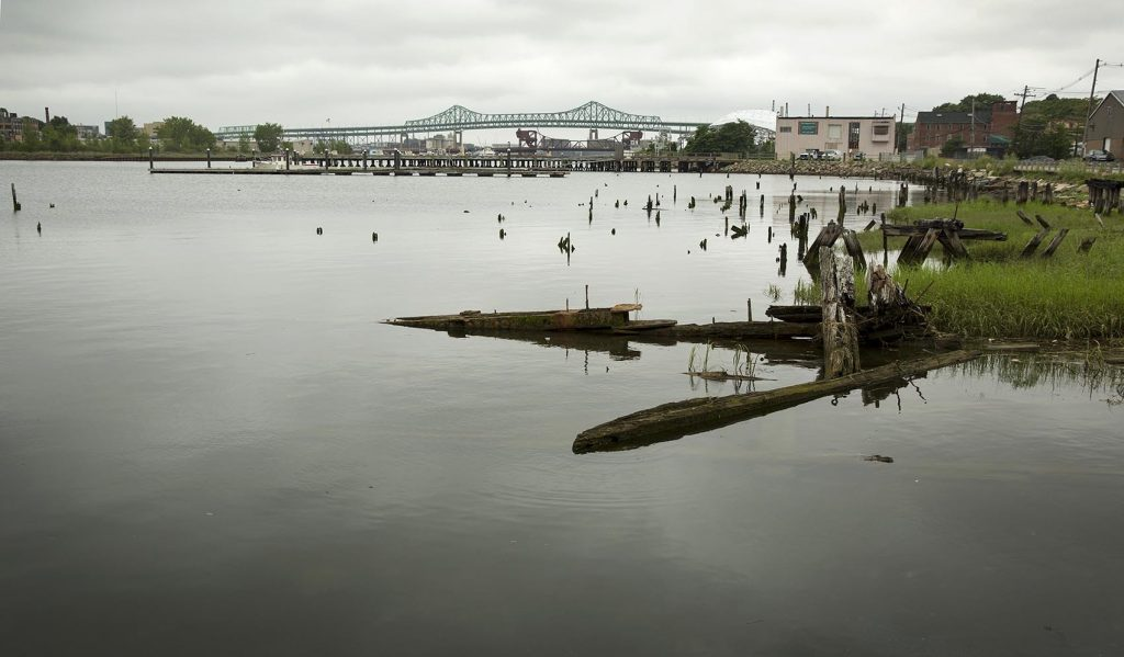 Several industrial sites are located on the Chelsea Creek in Chelsea, Massachusetts. Photo by Robin Lubbock for WBUR