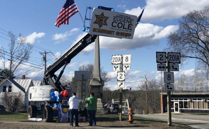 Mourners gather at a makeshift memorial for Cpl. Eugene Cole on Saturday, April 28, 2018. Photo by Callie Ferguson for the Bangor Daily News