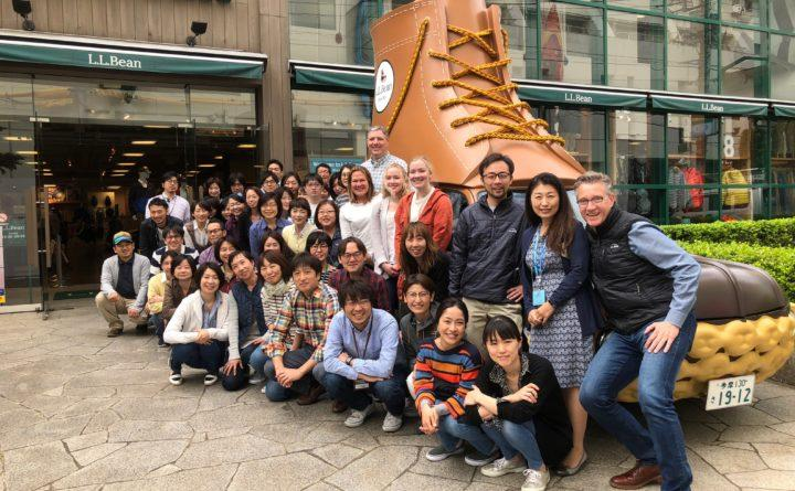 Zane Shatzer (front), managing director of Japan and Asia Pacific for L.L.Bean International, with his marketing team and the Japanese L.L.Bean Bootmobile, in the Kichioji section of Tokyo, where the L.L.Bean Japan branch office is headquartered. Courtesy of L.L. Bean