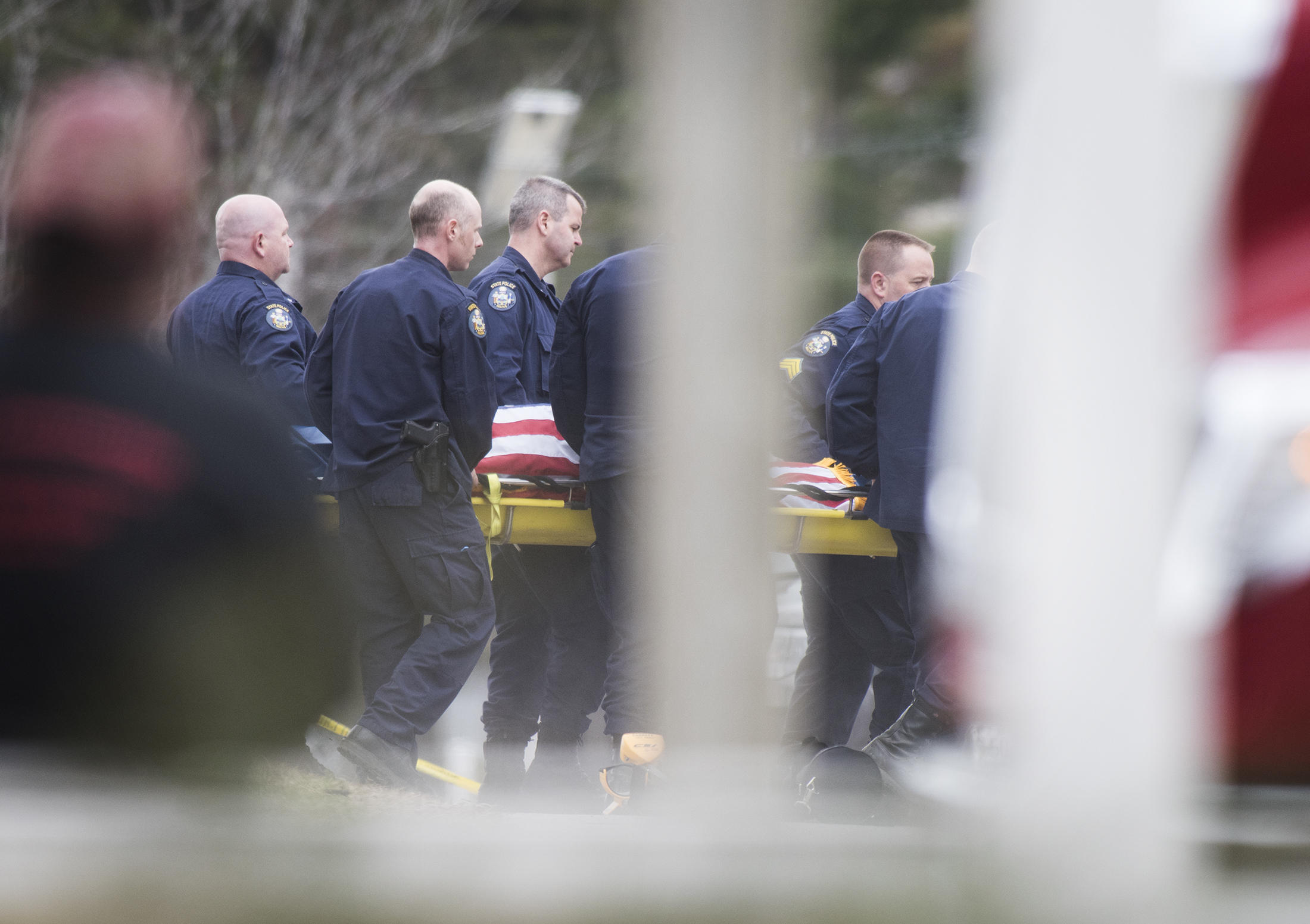 The body of Somerset County Sheriff's Deputy Eugene Cole is brought out and loaded into a medical examiner's van on Wednesday, April 25, 2018. Photo by Kevin Bennet for Maine Public
