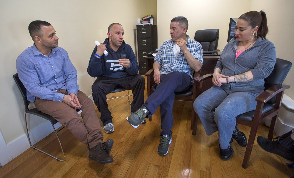 From left to right: Felito Diaz, Julio Cesar Santiago, Richard Lopez and Irma Bermudez speak at Casa Esperanza, a collection of day treatment, residential programs and transitional housing in Roxbury. Photo by Jesse Costa for WBUR
