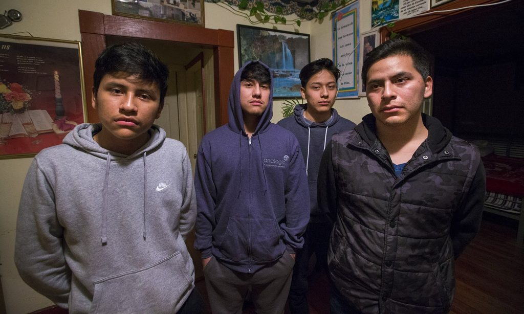 Isidro Macario, 27 right, wes brought here as a young child from Guatamala is facing deportation potentially making him leave behind the rest of his family, (l-r) Saul, 16, Anthony, 18 and Erwin, 21, who were born in the United States. (Jesse Costa/WBUR)