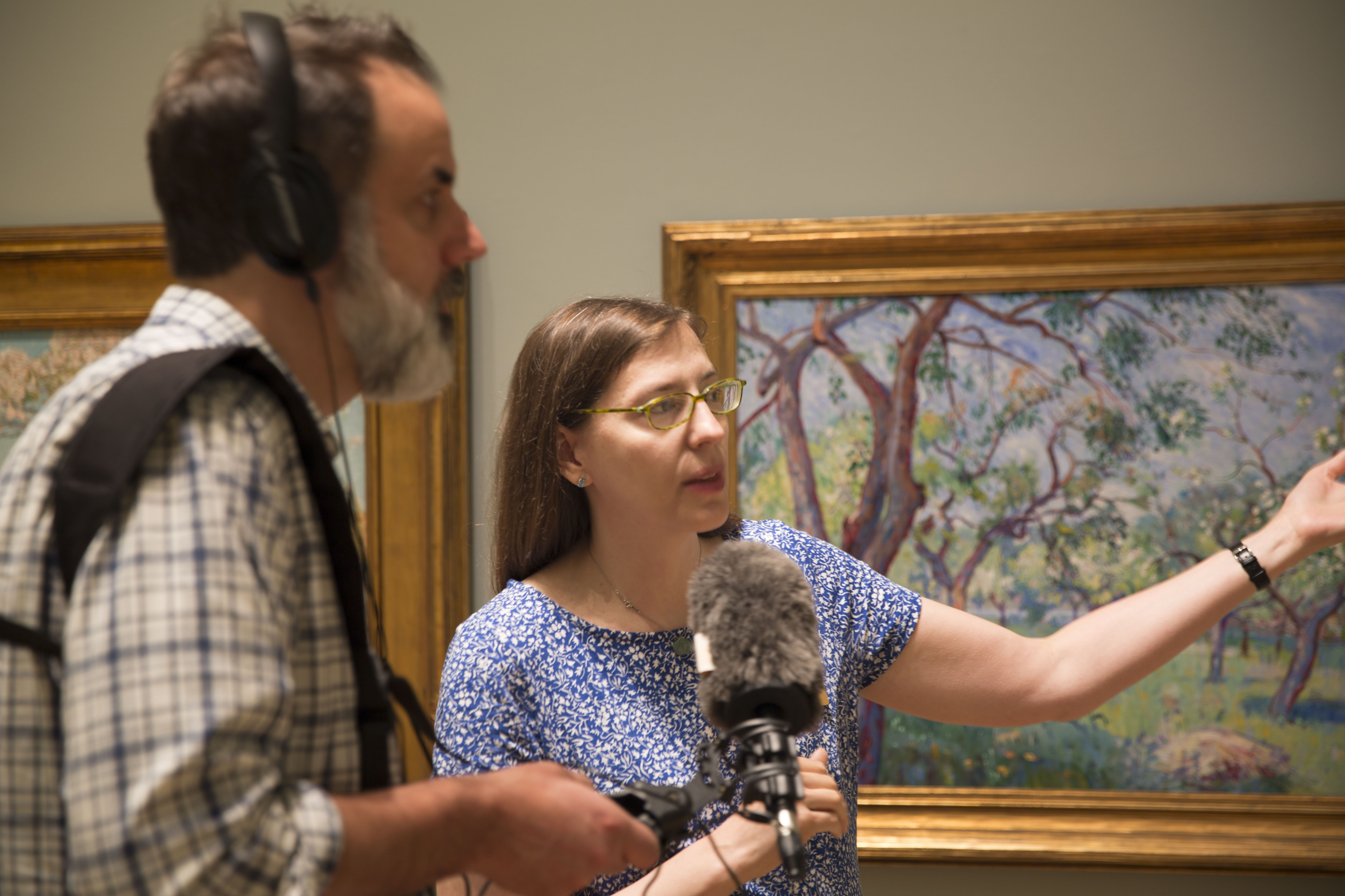 "Curator Amy Kurtz-Lansing shows John Dankosky the ""Art and the New England Farm"" Exhibit at the Florence Griswold Museum. Photo by Carlos Mejia for Connecticut Public Radio"