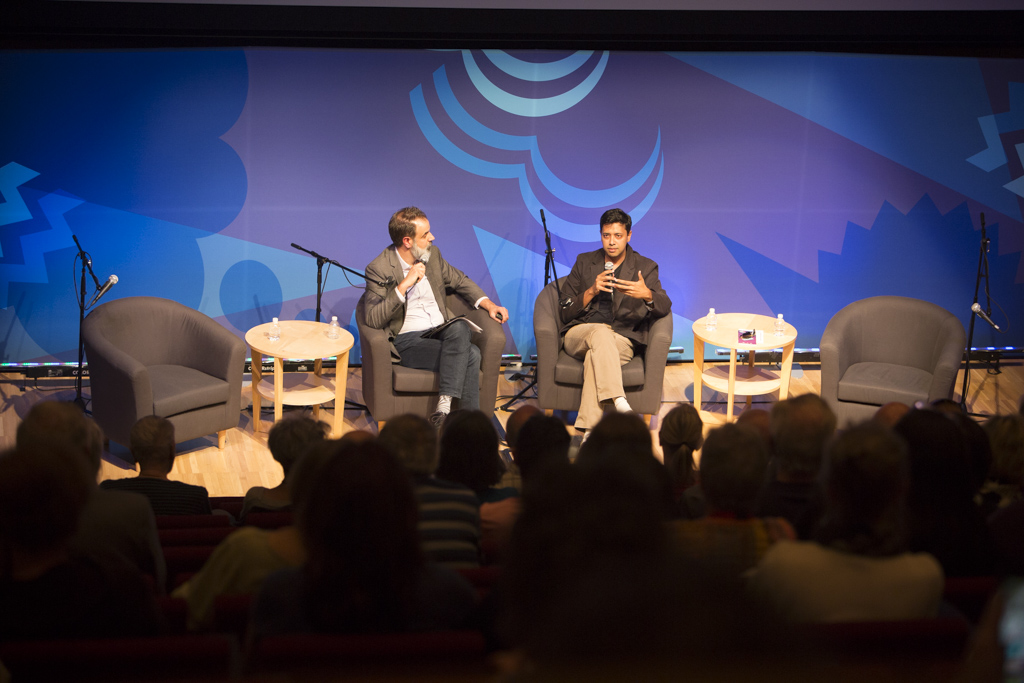 John Dankosky interviews Mushfiq Mobarak at a live Arts and Ideas Panel. Photo by Judy Rosenthal
