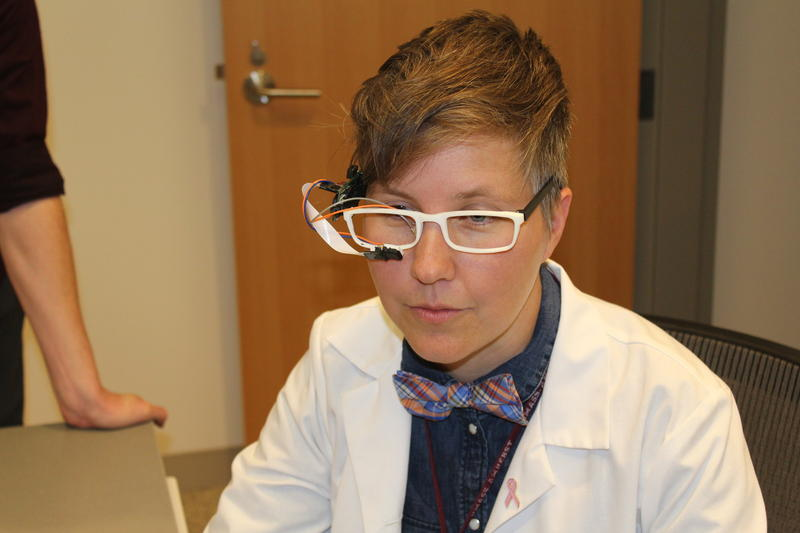 Nurse Rachel Walker, demonstrating one of her inventions. Photo by Heather Duggan from UMass