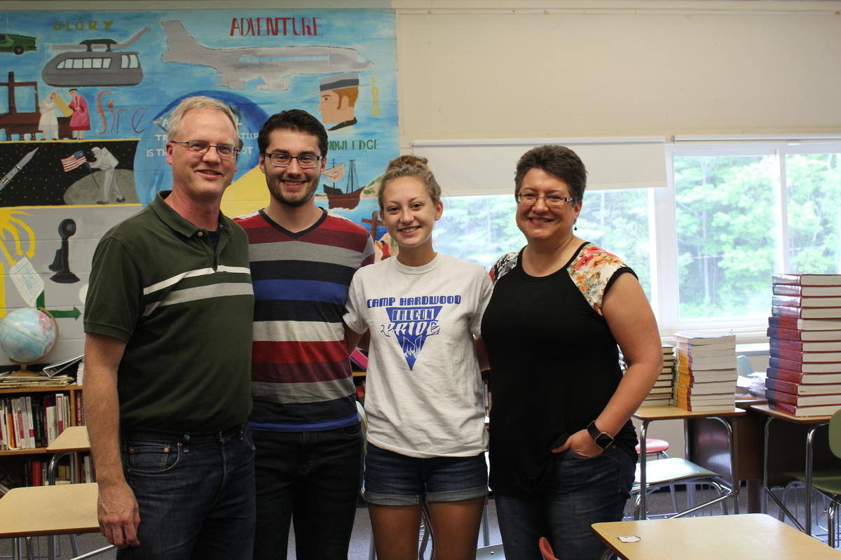 Teachers Chris and Deborah Carver pose with their two children, Brooke and Garrett, inside of a classroom at Mountain Valley High School in Rumford, Maine. Photo by Robbie Feinberg for Maine Public