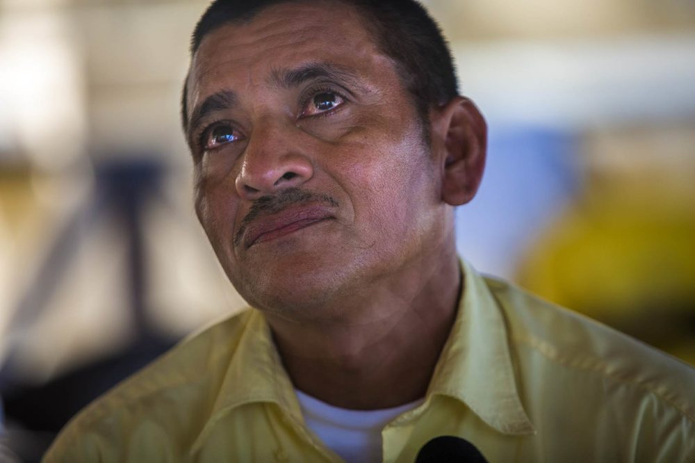 Jose Hector Galvez eyes fill with tears as he talks about his 16-year-old daughter still being detained in the U.S. after they were caught crossing the border earlier this summer. Photo by Jesse Costa for WBUR