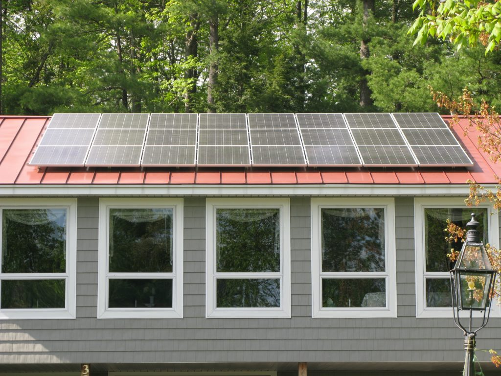 Solar panels at Shaker Woods Farm. Photo by Keith Shields for NHPR