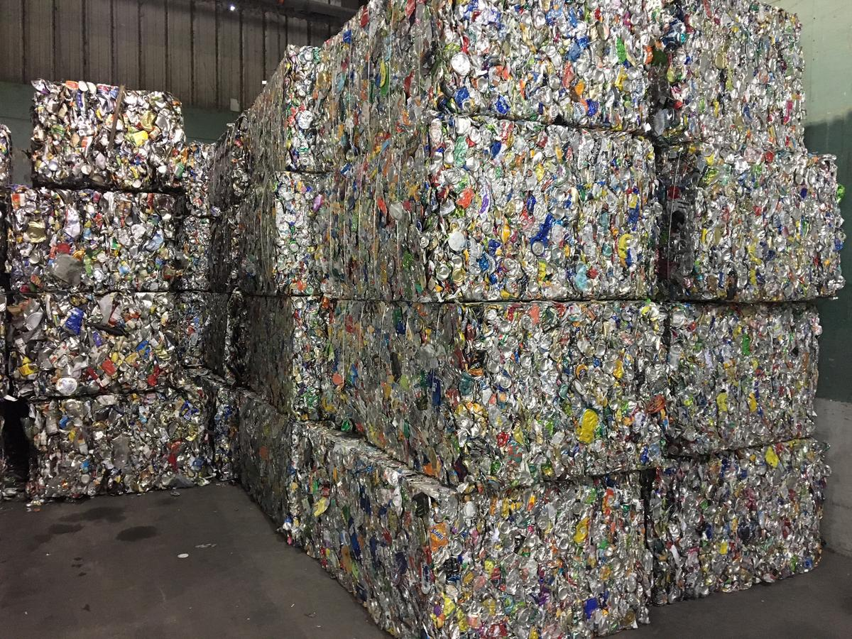 Bales of recyclable aluminum and steel cans ready to be shipped at the Chittenden Solid Waste District. Photo by John Dillon for VPR