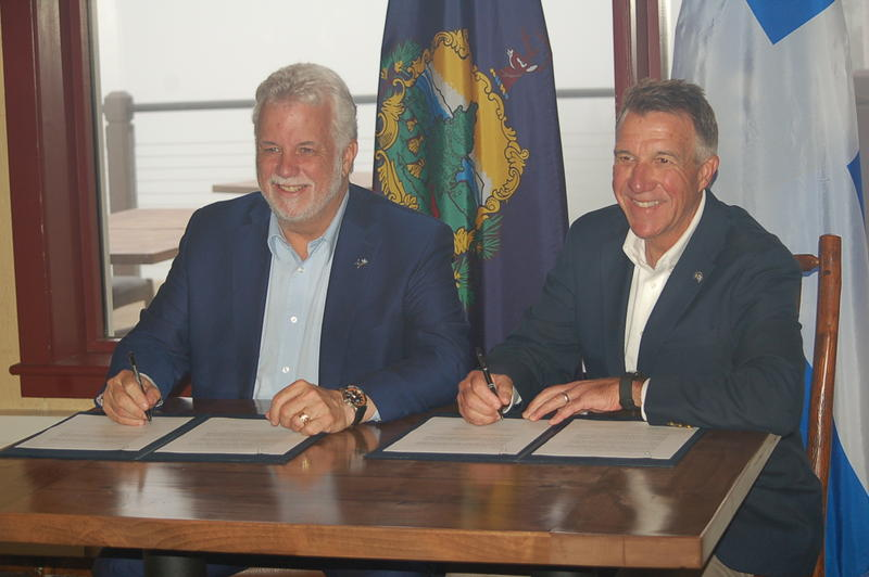Quebec Premier Philippe Couillard, left, and Vermont Gov. Phil Scott Sunday signed a bilateral agreement pledging continuing cooperation on a host of cross-border issues. Photo by John Dillon for VPR