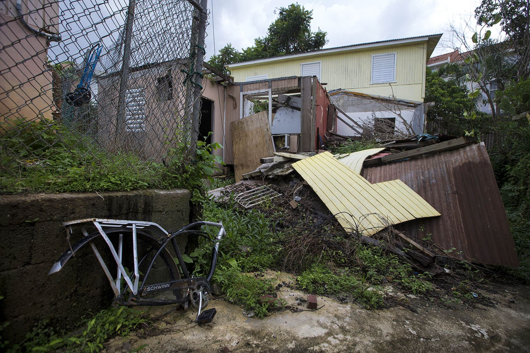 A house in Guaynabo, which was completely leveled by Hurricane Maria, still sits in ruin one year after the storm. Photo by Jesse Costa for WBUR