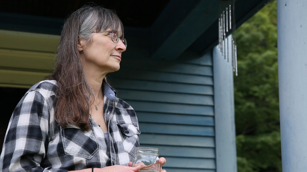 Hilary Mullins stands outside her Vermont home after she detailed the abuse she suffered as a teenager by two teachers from the Connecticut boarding school. Photo by Frankie Graziano for Connecticut Public Radio