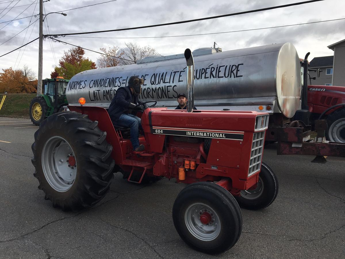 Farmers led a tractor parade down the streets of Granby, Quebec to protest the new trade deal. Photo by John Dillon for VPR