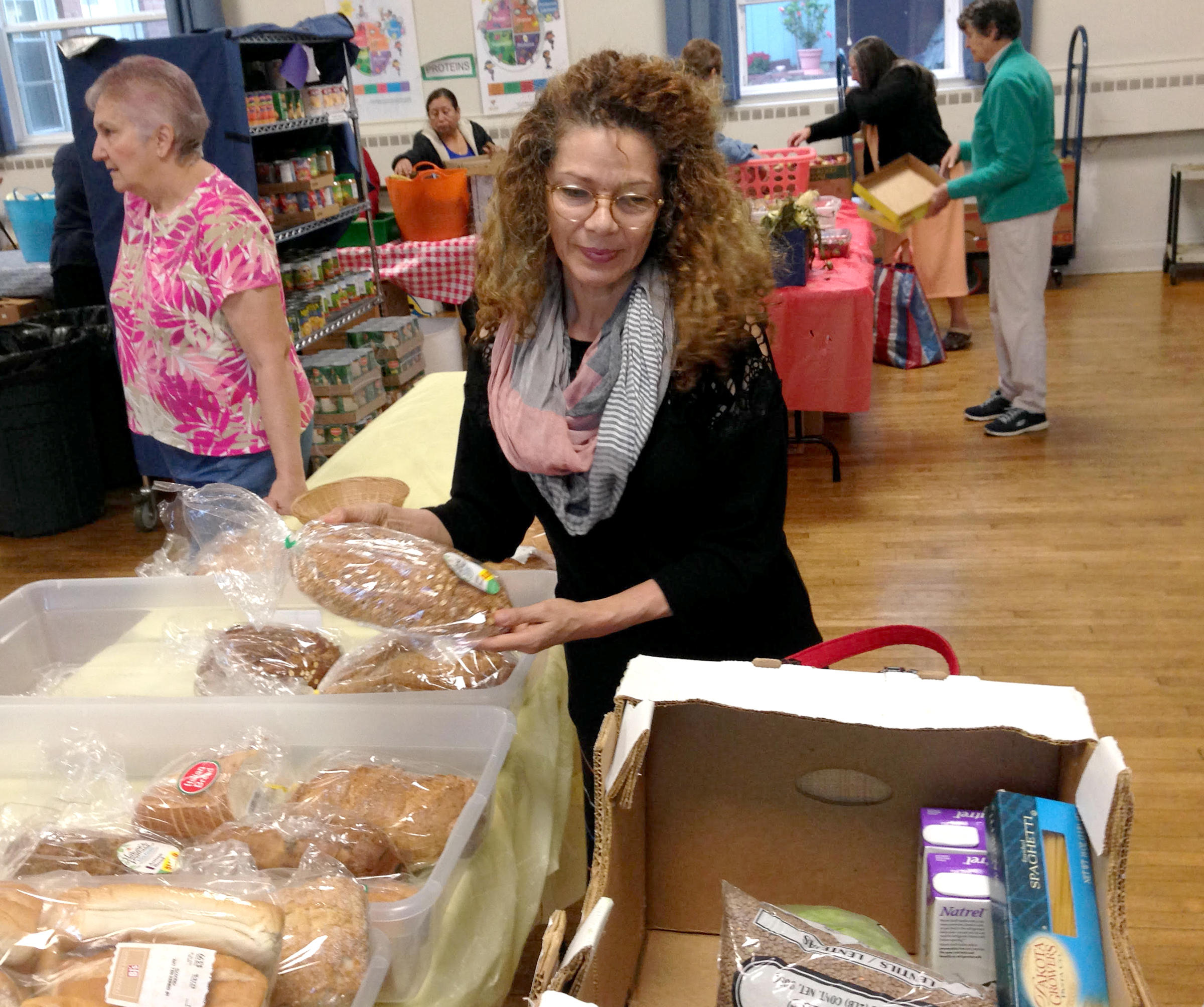 Oliva Llano visits the food pantry. Photo by Nancy Eve Cohen for NEPR