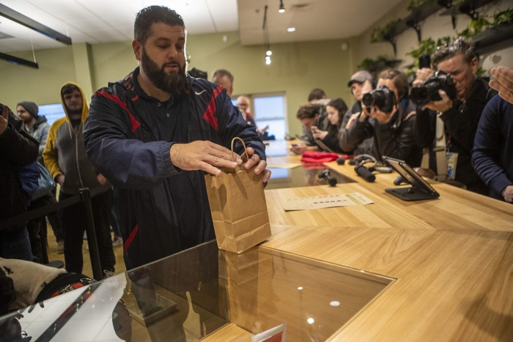 Veteran Steven Mandile make the first purchase of recreational marijuanain Massachusetts at Cultivate in Leicester. Photo by Jesse Costa for WBUR
