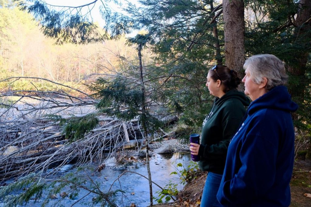 Chelsie Lent and Carole Clarke are co-owners of Scenic View Campground in Warren, NH. The Baker River, which runs along the back of their property, has flooded multiple times in recent years. Photo by Britta Greene for NHPR