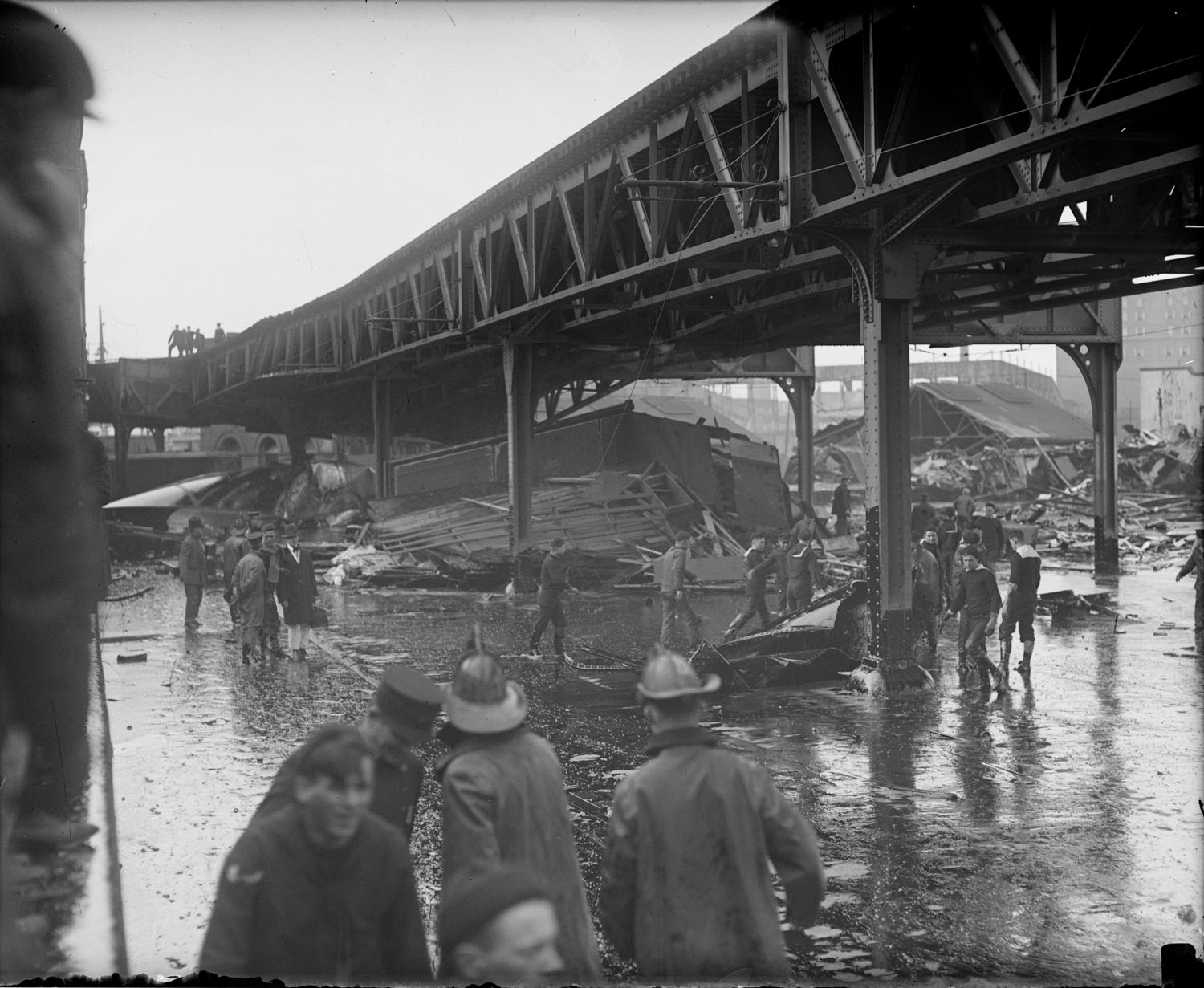 Wreckage under the elevated where many express trucks parked, Molasses Disaster. Photo courtesy of the Boston Public Library, Leslie Jones Collection