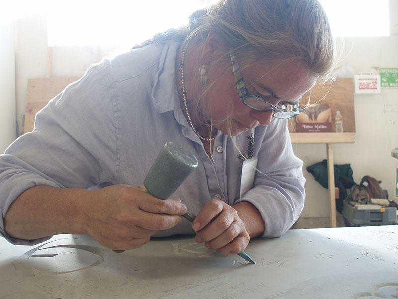 Karin Sprague is among a small group of artists who still etch stone memorials by hand. Photo courtesy of Karin Sprague