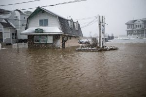 Floodwater rises in Marshfield during the nor'easter on March 13, 2018. Photo by Jesse Costa for WBUR