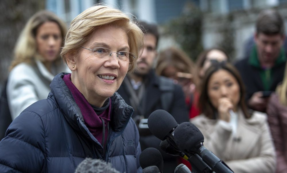 Massachusetts senator Elizabeth Warren talks with reporters outside her home in Cambridge Mass. after announcing that she is setting up an exploratory committee for a run for the presidency in 2020. Photo by Robin Lubbock for WBUR