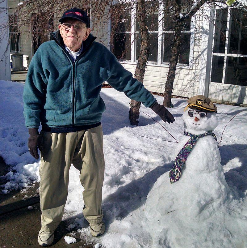 Warren Patrick of Townshend still has the energy to build a snowman in the middle of winter. Photo by Dawn Slade for Valley Cares