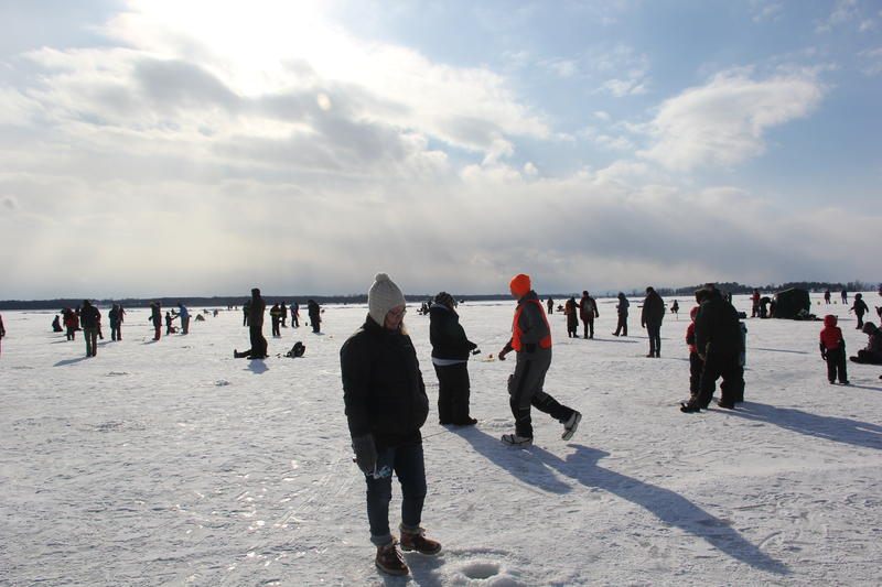 Hundreds of people walked out onto frozen Lake Champlain in North Hero for the sixth annual Ice Fishing Festival on Saturday. Photo by Bayla Metzger for VPR