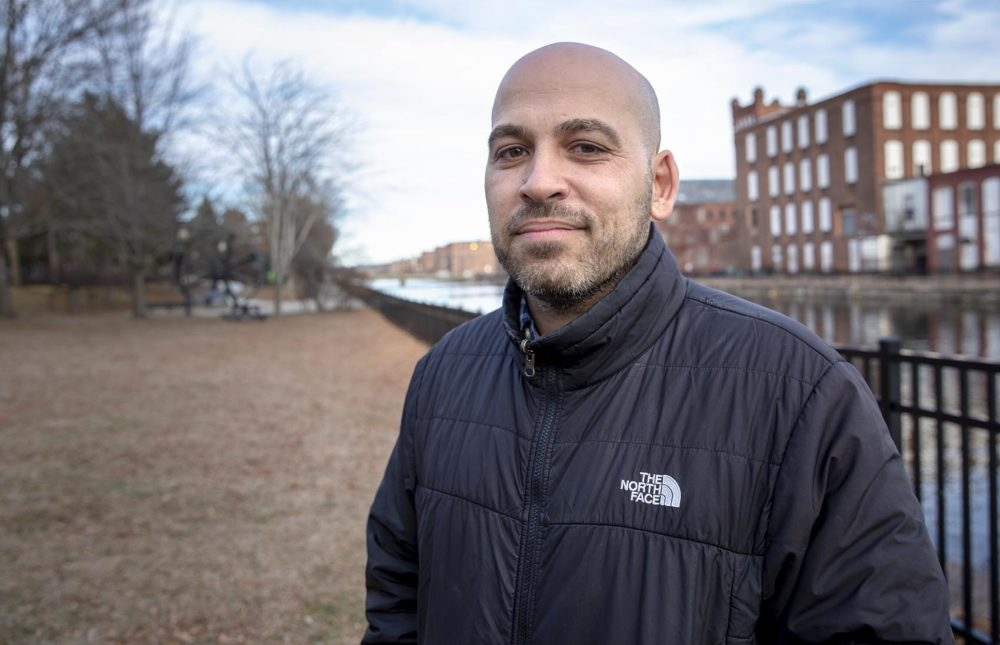 Jose Bou, Equity Family And Community Partnerships Manager with Holyoke Public Schools, by the first level canal in Holyoke. Photo by Robin Lubbock for WBUR