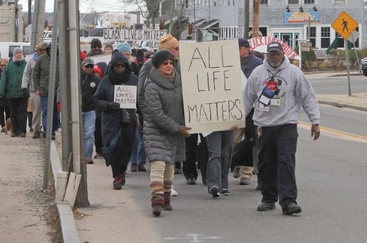 Richard Shepard and Joyce Rickson lead the way during NAACP organized march. January 2015. Vineyard Haven, MA. Photo by Ivy Ashe.