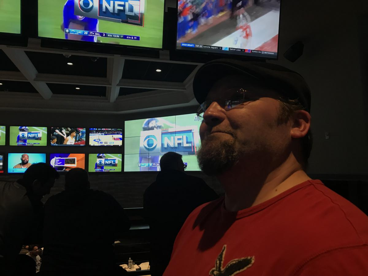 """""""We're like a deer in headlights -- we're staring at other states around us and yet we're afraid to do it because we're a conservative state,"""" said East Hartford resident Mark Titan regarding movement on the legalization sports betting. Photo by Frankie Graziano for Connecticut Public Radio"""