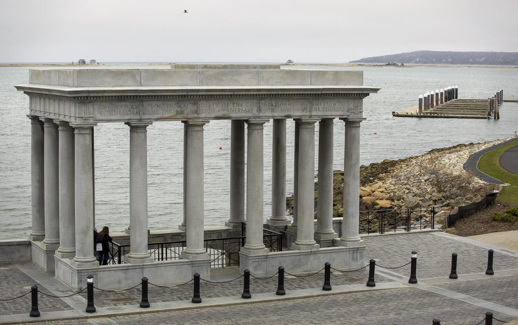 The Plymouth Rock portico looks out across the Plymouth Bay to Rocky Point, the location of Pilgrim Nuclear Power Station. Photo by Robin Lubbock for WBUR