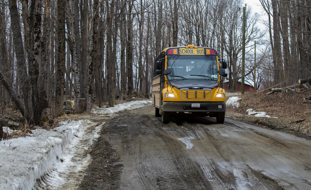 Joanne Deady's school bus navigates carefully over a icy lined and greasy mud covered Christian Hill Rd. Photo by Jesse Costa for WBUR