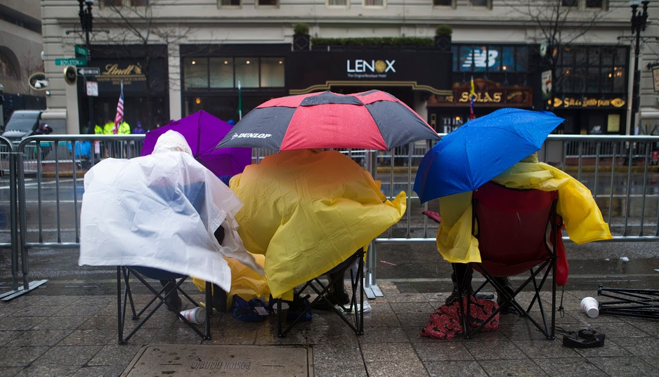 Spectators camped out in the wind and rain along Boylston St. Photo by Jesse Costa for WBUR