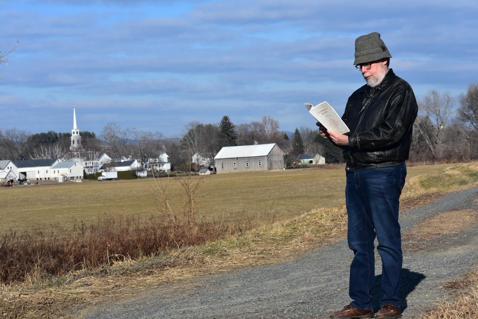 "Forrest Proper reads from the anthology ""Compass Roads"" at an elbow of the Connecticut River in Hatfield, Massachusetts. Photo by Carrie Healy for NEPR"