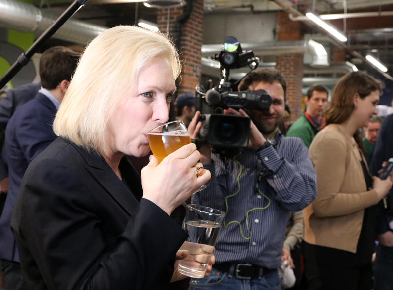 Photo by Allegra Boverman. U.S. Sen. Kirsten Gillibrand, a Democratic candidate for President, visited To Share Brewing Company in Manchester on Friday evening. There was a drink there named for her on tap, Kirstenweizen, which she sampled. Photo by Allegra Boverman for NHPR