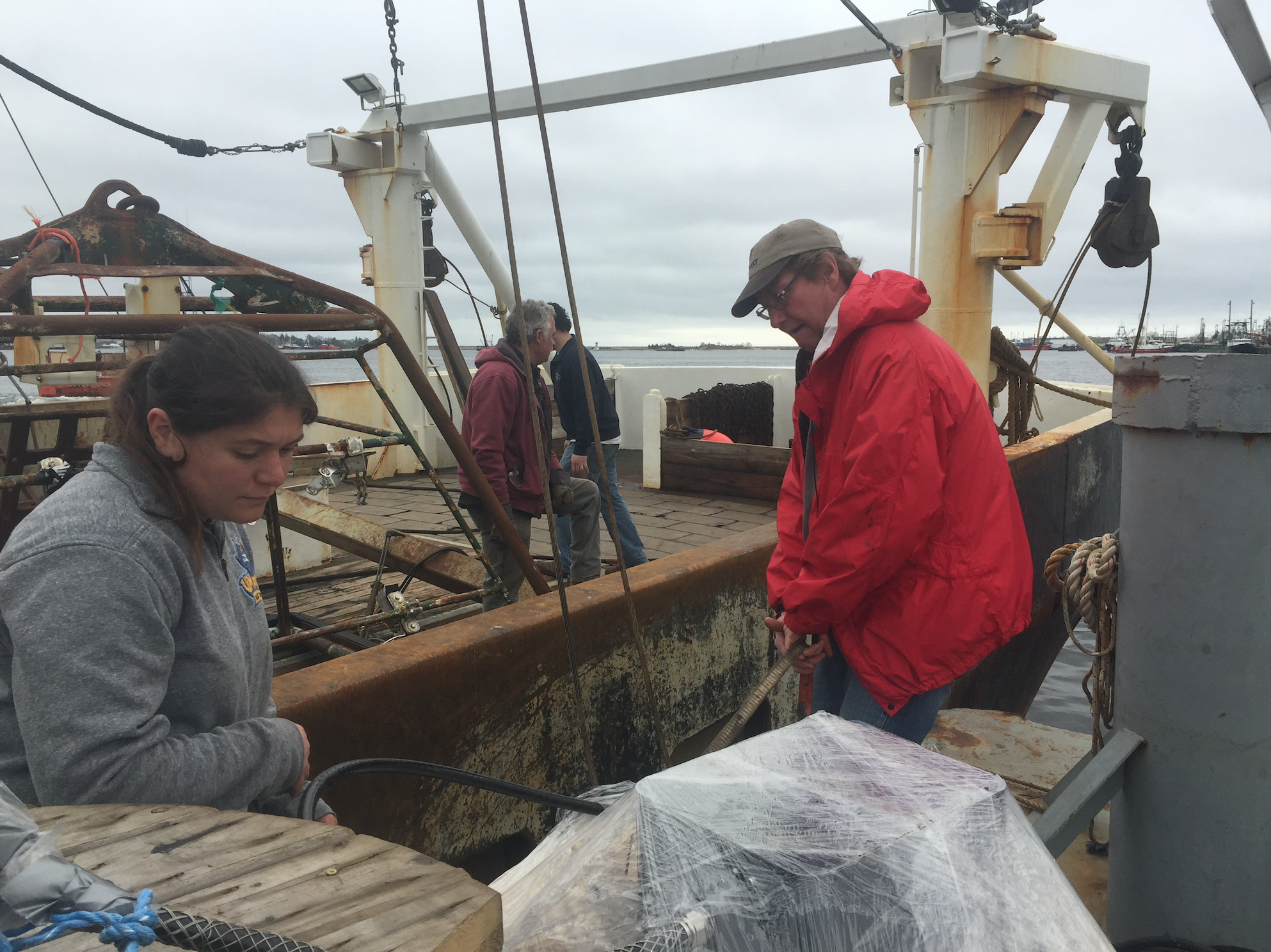Dr. Kevin Stokebury, right, and his team on boat Liberty preparing for the last sea scallop survey before Vineyard Wind begins construction. Photo by Nadine Sebai for The Public's Radio